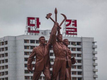 A typical communist style statue in the capital city of North Korea, photo by alexkuehni/Getty Images