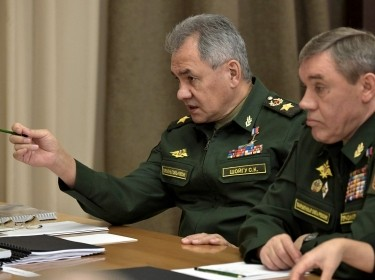"Russian Defence Minister Sergei Shoigu (left) and Chief of the General Staff, First Deputy Minister Valery Gerasimov, before a meeting with Russian Defence Ministry leadership and defense industry heads<a href=""http://static.kremlin.ru/media/events/photos/big2x/XkuxktnM8WnEwjbaFZgFjfTZ7jpIznTL.jpg"">photo</a> courtesy of Office of the Russian President/<a href=""http://en.kremlin.ru/about/copyrights"">Creative Commons Attribution 4.0 International</a>"