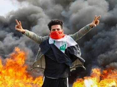 An Iraqi demonstrator gestures during the ongoing anti-government protests in Najaf, Iraq, November 18, 2019, photo by Alaa Al-MarjaniReuters