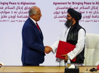 Mullah Abdul Ghani Baradar, the leader of the Taliban delegation, and Zalmay Khalilzad, U.S. envoy for peace in Afghanistan, shake hands after signing an agreement at a ceremony between members of Afghanistan's Taliban and the U.S. in Doha, Qatar, February 29, 2020, photo by Ibrahem Alomari/Reuters