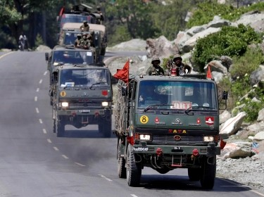 An Indian Army convoy moves along a highway leading to Ladakh, at Gagangeer in Kashmir's Ganderbal district, June 18, 2020, photo by Danish Ismail/Reuters