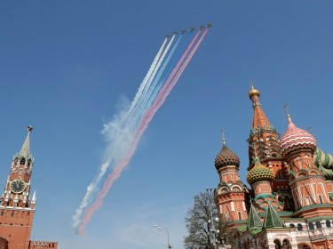 Russian Air Force Su-25 jets perform during the rehearsal for the Victory Day parade, with the Spasskaya Tower of the Kremlin and St. Basil's Cathedral seen in the foreground, in Moscow, Russia, May 4, 2018