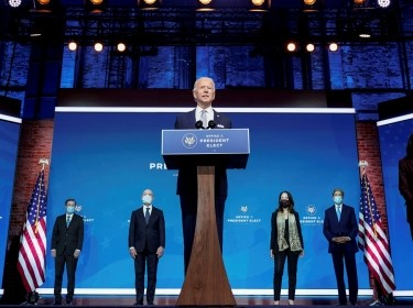 President-elect Joe Biden stands with his nominees for his national security team at his transition headquarters in the Queen Theater in Wilmington, Delaware, November 24, 2020, photo by Joshua Roberts/Reuters