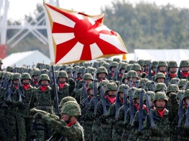 Members of Japan's Self-Defense Forces' infantry unit march during the annual SDF ceremony at Asaka Base, Japan, October 23, 2016, photo by Kim Kyung Hoon/Reuters