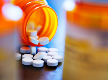 Close up of prescription pill bottle, photo by DNY59/Getty Images