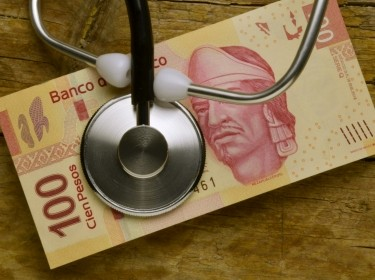 A stethoscope on Mexican pesos
