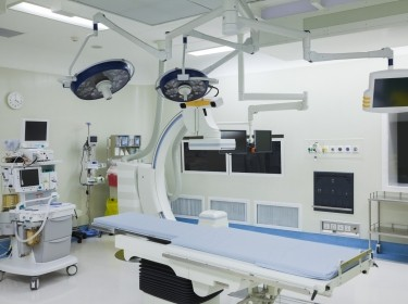 A hospital room with technological equipment