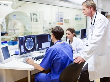 Doctors reviewing an MRI
