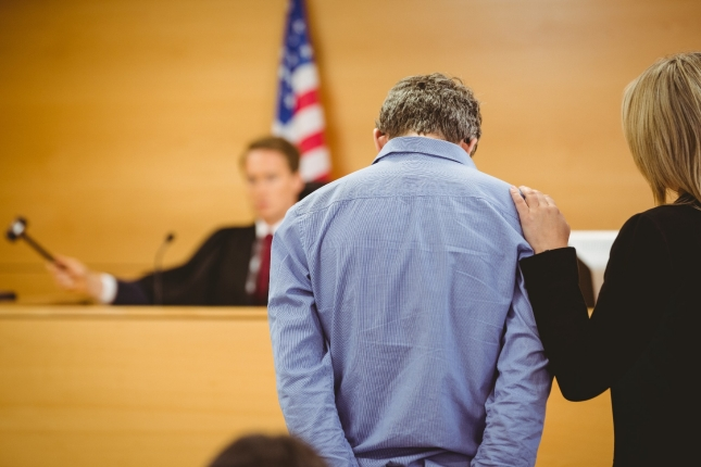 A man and his lawyer hear a ruling from a judge, photo by WavebreakmediaMicro/Fotolia