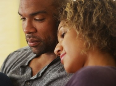 Young black couple on a couch