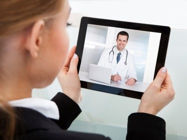 Woman having a video chat with doctor on a tablet