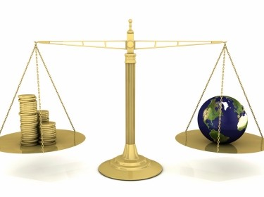 weighing scale with money and earth