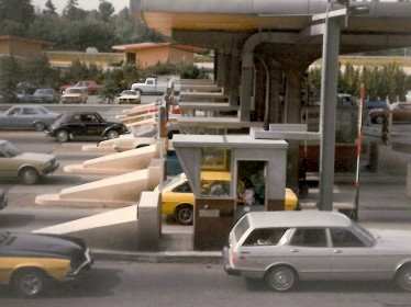 Cars go through Washington State toll booths