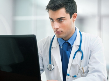 Doctor using a computer