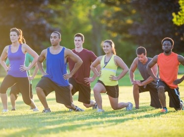 Outdoor fitness class with a mix of adults