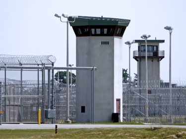 A prison fence and guard tower