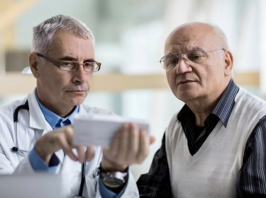Doctor discussing treatment with elderly man
