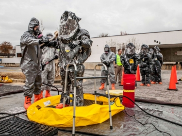 Emergency response personnel perform technical decontamination
