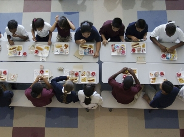 Students eating lunch in a school cafeteria