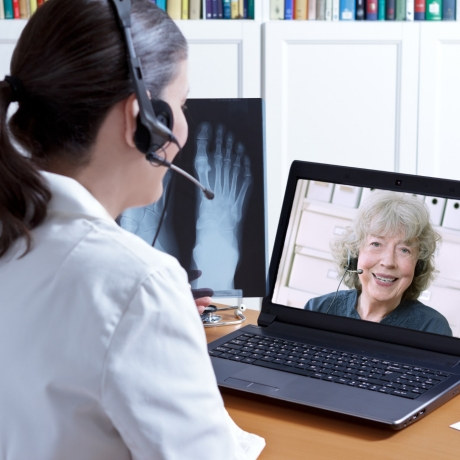 Woman talks to doctor using telemedicine, photo by Anja Schaefer/Fotolia