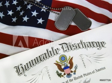 Military identification tags next to a certificate of Honourable Discharge on top of a United States flag