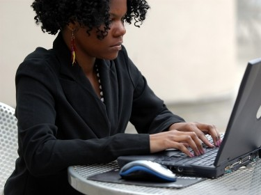 African American woman typing on a laptop computer