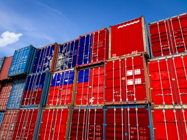 The national flag of Taiwan on a large number of metal containers for storing goods stacked in rows on top of each other. Conception of storage of goods by importers, exporters, photo by Sova Vitalij/AdobeStock