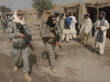 Female Engagement Team members Pfc. Kelly Shutka, Pfc. Rachel Miller, and Sgt. Richelle Aus patrol a bazaar in Zabul province, Afghanistan.