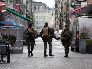 Three Belgian soldiers patrol in Brussels following a terrorism threat
