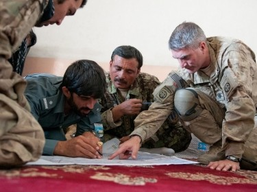 Soldiers discussing combined operations in Afghanistan, July 16, 2012