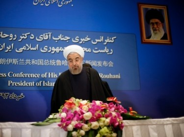 Iran's President Hassan Rouhani arrives at a news conference