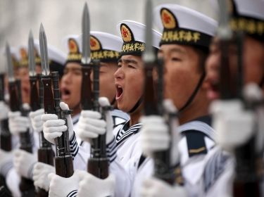 Chinese People's Liberation Army Navy recruits chant slogan during a parade