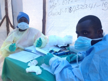 Government health workers administering blood tests for the Ebola virus in Kenema, Sierra Leone, June 2014