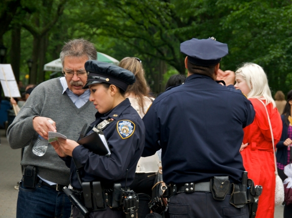 NYPD officers interact with pedestrians in Central Park, Manhattan, May 22, 2011, photo by JayLazarin/iStock