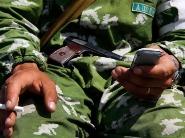 A pro-Russian rebel sends messages over his smartphone in the eastern Ukrainian town of Slaviansk, May 16, 2014