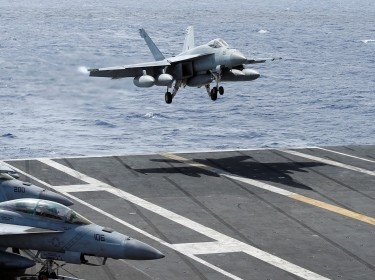 An F/A-18 Super Hornet lands on the deck of the USS Ronald Reagan in the South China Sea, September 30, 2017