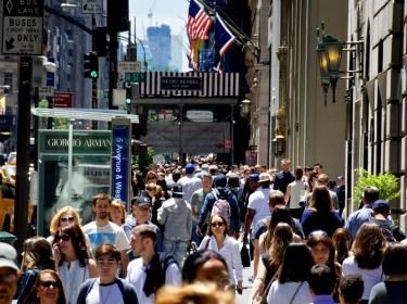 Pedestrians walk down Fifth Avenue in New York City