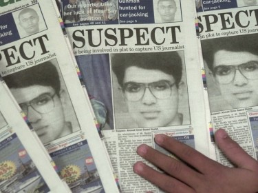 Newspapers from February 2002 display a photo of Ahmed Omar Saeed Sheikh, who was wanted for the kidnapping and murder of U.S. reporter Daniel Pearl