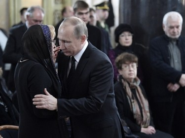 Russian President Vladimir Putin comforts the widow of Andrei Karlov, Russia's former ambassador to Turkey, at a memorial ceremony in Moscow, December 22, 2016, photo by Alexei Nikolskyi/Sputnik/Kremlin via Reuters