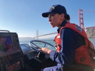 Petty Officer 1st Class Krystyna Duffy, a boatswain's mate assigned to Coast Guard Station Golden Gate in San Francisco, drives a 47-foot Motor Lifeboat near the Golden Gate Bridge, February 8, 2018, photo by PO3 Sarah Wi/U.S. Coast Guard