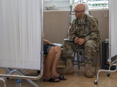 A patient speaks to an Army psychiatrist
