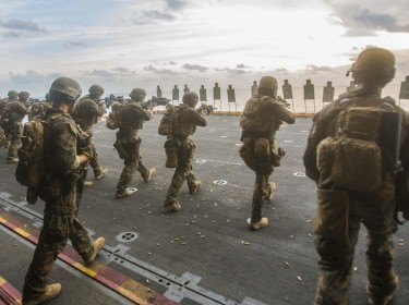 Marines train on the deck of a ship during a deployment