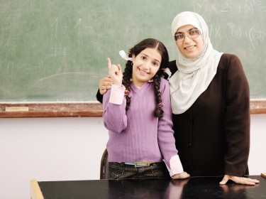 Teacher and little girl together