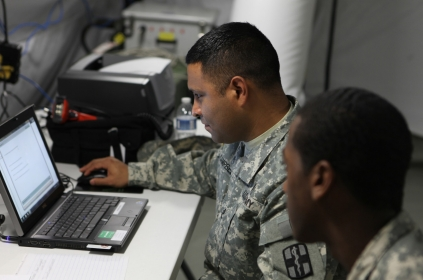 A soldier evaluates the new EMR system