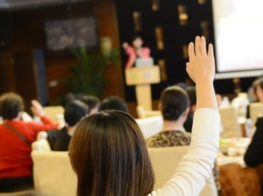 Girl raising her hand in a classroom