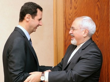 Syria's President Bashar al-Assad welcomes Iran's Foreign Minister Mohammad Javad Zarif before a meeting in Damascus January 15, 2014