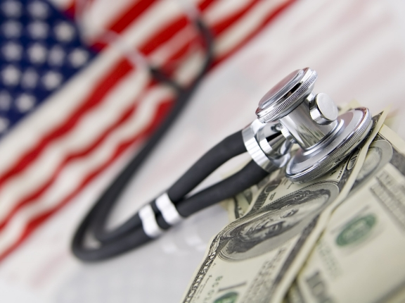 American flag, stethoscope, and money, photo by B-DIZZY/Fotolia