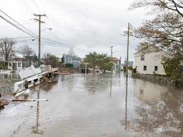 A flooded street in an oceanside community after Hurricane Sandy.