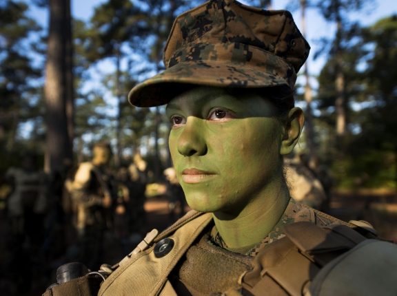 Pfc. Christina Fuentes Montenegro prepares to hike to her platoon's defensive position during patrol week of Infantry Training Battalion near Camp Geiger, N.C. in Oct. 2013, photo by Sgt. Tyler Main/U.S. Marine Corps