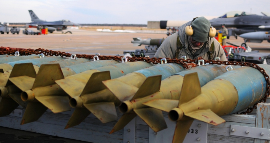 U.S. Air Force Staff Sgt. Antonio Diaz inspects munitions before they are mounted onto an F-16C Fighting Falcon during flightline operations Jan. 9, 2015, at Atlantic City Air National Guard Base, N.J., photo by U.S. Air Force/Airman 1st Class Shane Karp